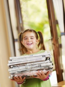girl with newspapers